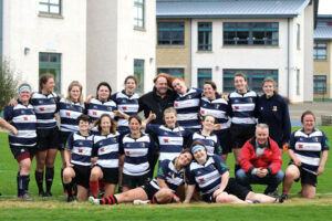 Aberdeenshire Quines pose for team photo with management team before a game