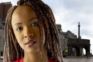 Young woman or girl with dreadlocks at Aberdeen's Castlegate