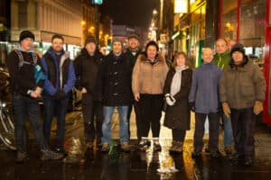 Street Connect volunteers posing at night on a Glasgow street