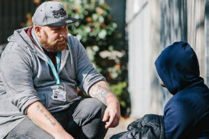 Support worker speaking with person experiencing homelessness